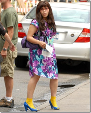 Fashion faux pas: ugly betty wearing socks with high heels